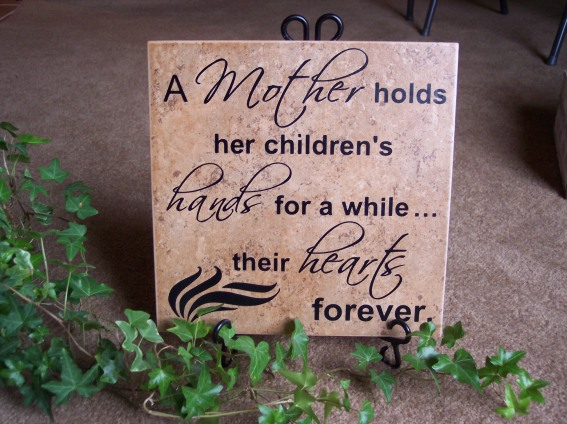 A mother holds her children's hands for a while . . . their hearts forever.